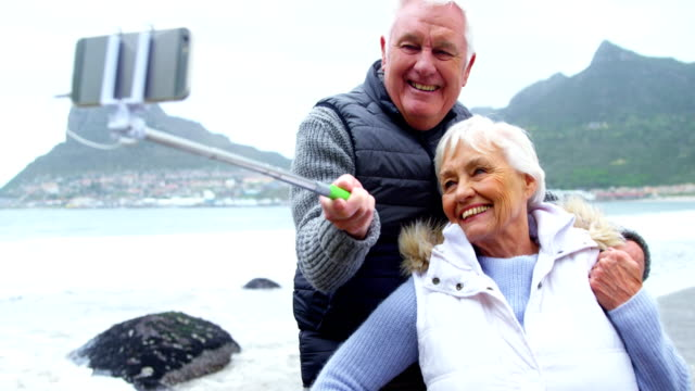 Senior couple taking a selfie from selfie stick video