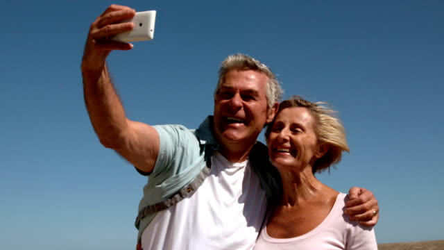 Senior couple taking a selfie on sunny day video