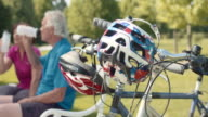 SLO MO Senior couple taking break from cycling video