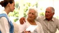 Senior couple talking to nurse video