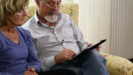 Senior Couple Using Tablet Computer video