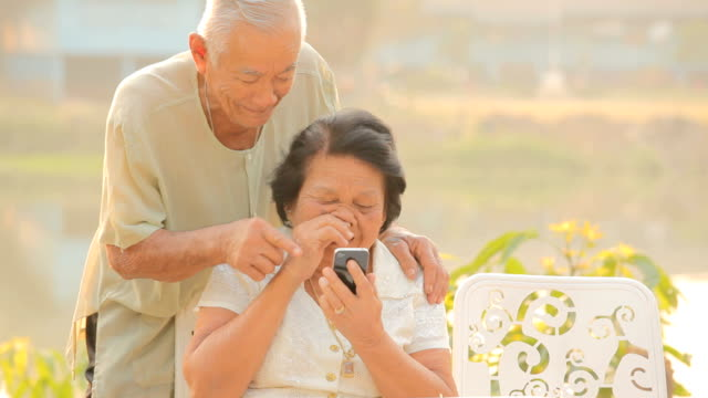 Senior couple using the mobile phone video