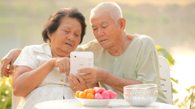 Senior couple using the tablet video