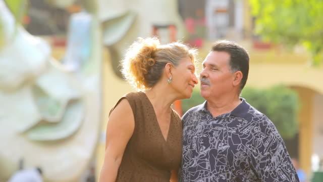 Senior couple walk together video