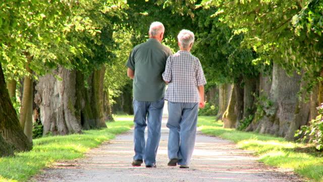 HD: Senior Couple Walking Down The Road video