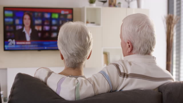 DS Senior couple watching news on TV video