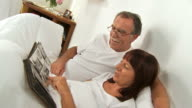 HD: Senior Couple Watching Photo Album video