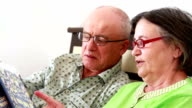 Senior Couple Watching Photo Album video