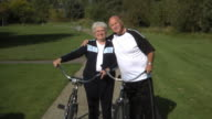 Senior couple with bicycles video