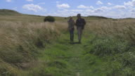 Senior Couple With Binoculars Walking In Countryside video
