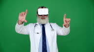 Senior doctor using virtual reality glasses  on a green background video