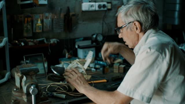 Senior engineer working in garage video