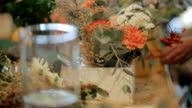 Senior expert of the master florist working with flowers, bouquets, boutonnieres, herbs, plants video