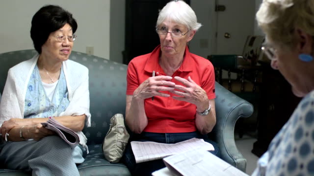 Senior Female Discusses Issues with Small Group video