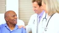 Senior Female Doctor Examining Patient video