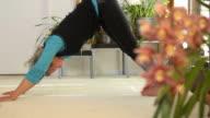 Senior Female doing Yoga video