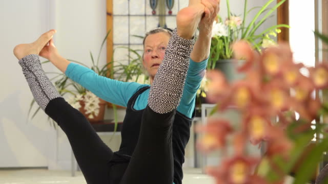 Senior Female doing Yoga video