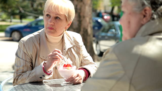 Senior Female Friends At Sidewalk Cafe video