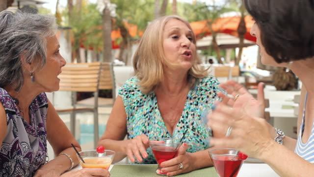 Senior Female Friends Enjoying Cocktails In Bar Together video