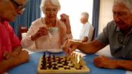 Senior friends playing chess video