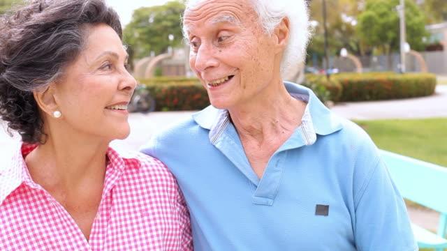 Senior Hispanic Couple Walking Through Park Together video