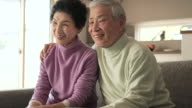 Senior husband and wife have a happy moment together video