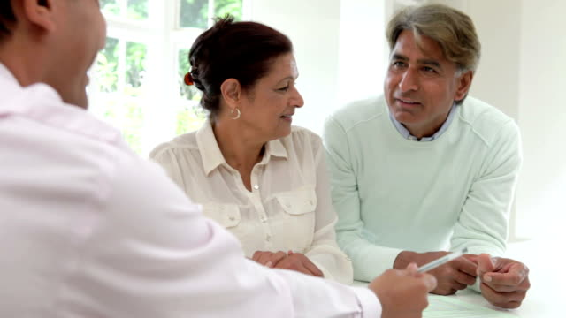 Senior Indian Couple Meeting With Financial Advisor At Home video