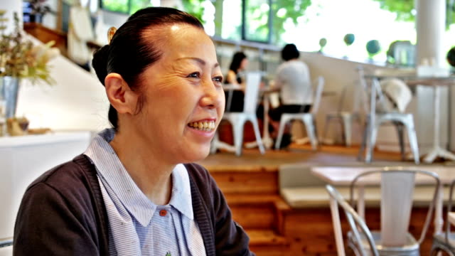 Senior Japanese Woman Smiling in a Cafe video