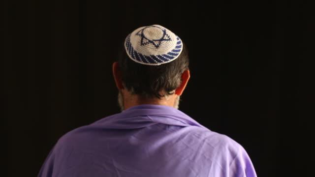 Senior jewish man praying ,holy book in hand video