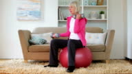 Senior lady exercising at home video