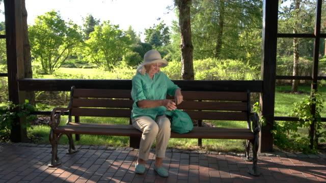 Senior lady has backache. video