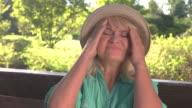 Senior lady has headache. video
