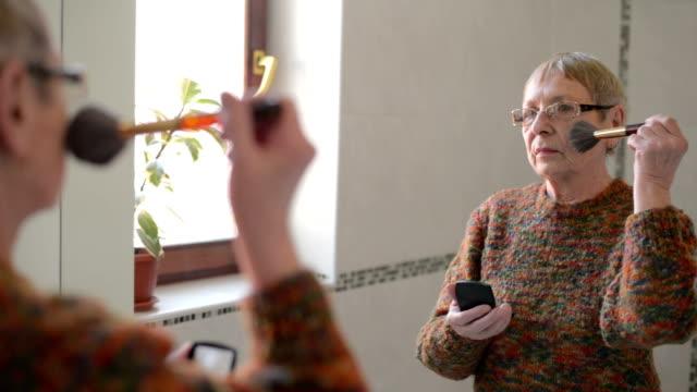 Senior lady putting make up video