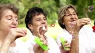Senior ladys blowing bubbles video