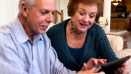 Senior Latin Couple Using Tablet Computer video