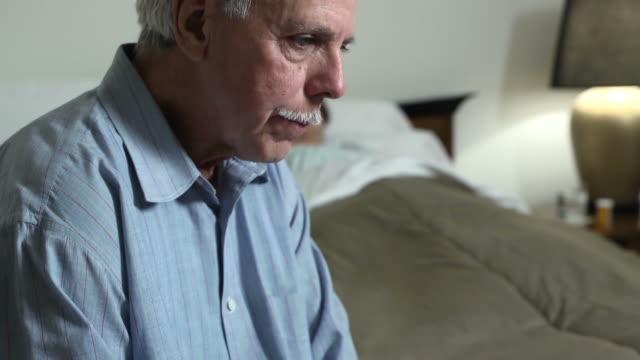 Senior Latin Man Expresses Concern for Sick Woman video