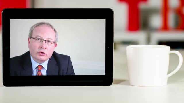 Senior lawyer consultation on digital tablet video