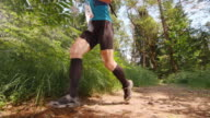 SLO MO CS Senior male competitor running marathon through forest video