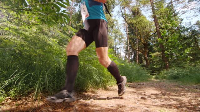 SLO MO CS Senior male competitor running a marathon through the forest video
