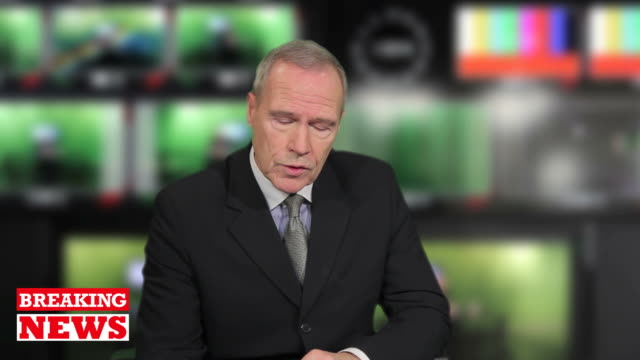 Senior male Newsreader in television studio video