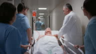 DS Senior male patient going to OR with medical team video