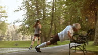 DS Senior male runner doing push ups on a park bench video