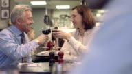 MS PAN Senior man and mature woman drinking wine video
