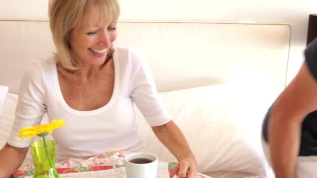 Senior Man Bringing Wife Breakfast In Bed video