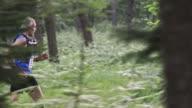 SLO MO DS Senior man competing in a trail run marathon video