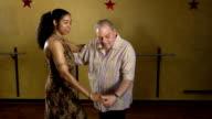 Senior Man Dancing Salsa with Attractive Woman video