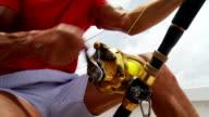 Senior man deep sea fishing video