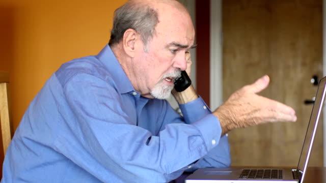 Senior Man Discusses Documents over Phone video