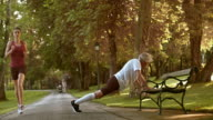 DS Senior man doing pushups on a bench in park video