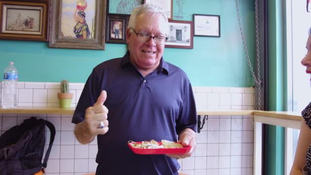 Senior Man Enjoying Tacos video